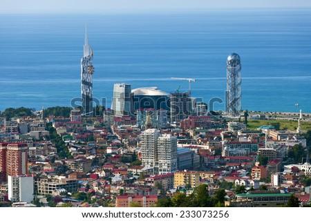 BATUMI, GEORGIA - SEPTEMBER 7: Aerial view of seaside city on Black Sea coast, high landmark building of Batumi Technological University and Alphabet Tower on September 9, 2014 in Batumi, Georgia.  - stock photo