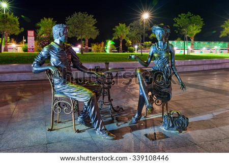 "BATUMI, GEORGIA - September 20, 2015: Night view of sculpture composition "" Me, You and Batumi "" in Miracle Park near Alphabetic Tower. - stock photo"