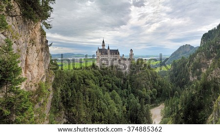 BAVARIA, GERMANY - AUGUST 27, 2010: View of Neuschwanstein Castle from Marie's Bridge in cloudy day. More than 1.3 million people visit the castle annually, with as many as 6,000 per day in the summer - stock photo