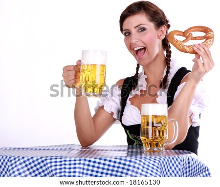 Bavarian brunette woman on blue white table with beer and snack - stock photo