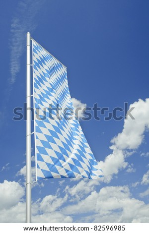 Bavarian flag with blue sky in Germany. - stock photo
