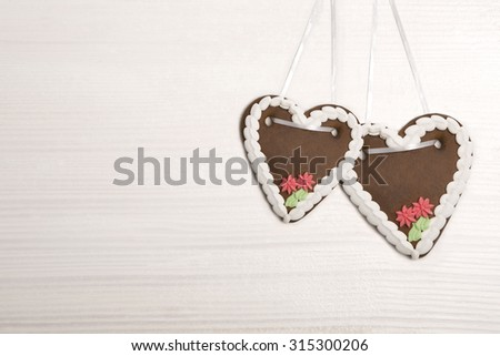 Bavarian gingerbread hearts for Oktoberfest in white background - stock photo