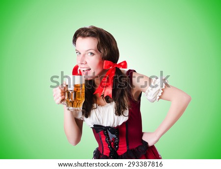 Bavarian girl with tray against the gradient - stock photo