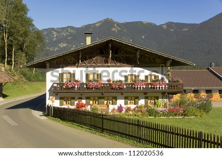 bavarian guesthouse with gabled roof - stock photo