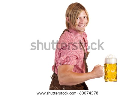 Bavarian man shows biceps muscles and holds oktoberfest beer stein.  Isolated on white background. - stock photo