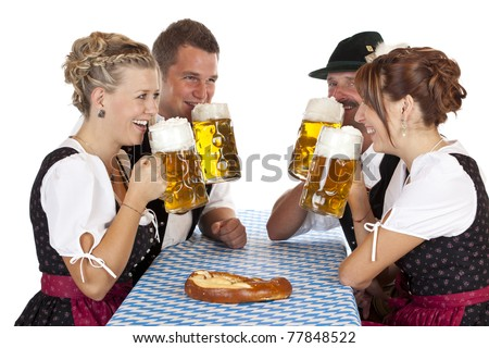 Bavarian men and women drink cheerfully Oktoberfest beer stein. Isolated on white background. - stock photo