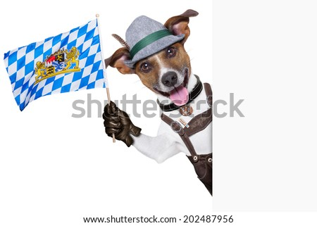bavarian oktoberfest dog  smiling happy  and waving with bavarian flag besides a white blank banner or placard