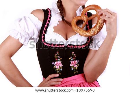 Bavarian pretzel with woman in dirndl - stock photo