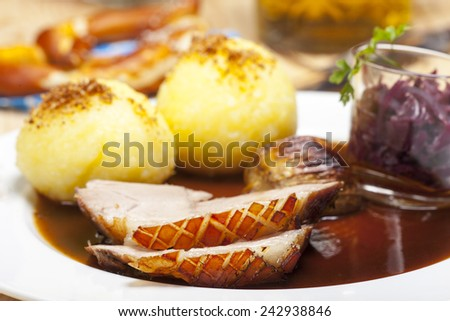 bavarian roasted pork on a plate  - stock photo