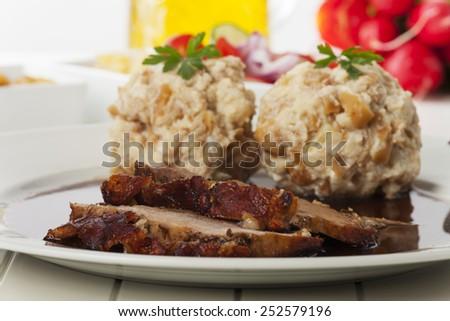 bavarian roasted pork with dumplings  - stock photo