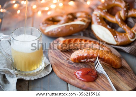bavarian sausages with bretzel and beer - stock photo
