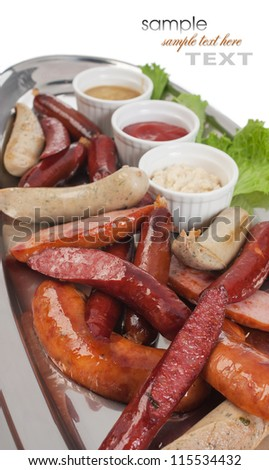 Bavarian sausages with ketchup isolated on a white background