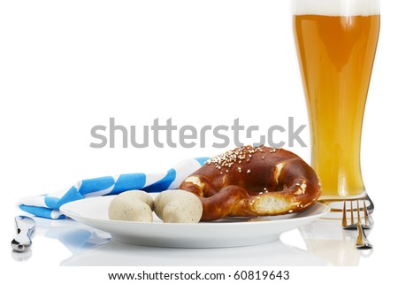 bavarian veal sauages on a plate with beer, pretzel and bavarian towel on white background - stock photo