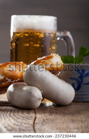 bavarian white sausages with bretzel and beer  - stock photo