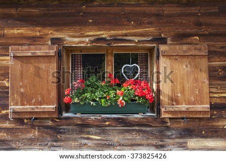 bavarian window with geranium  - stock photo