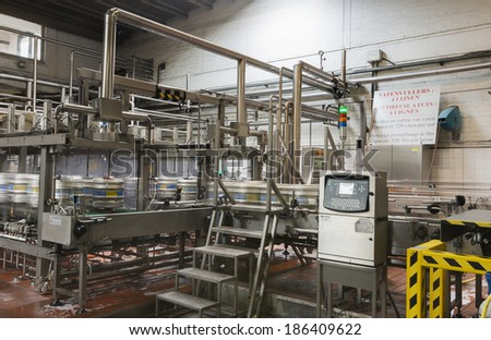 BAVIKHOVE, BELGIUM - CIRCA MARCH 2014: Automated keg rinsing and filling machine with four lines at Brewery De Brabandere. - stock photo