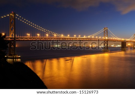 Bay Bridge, San Francisco at dusk. Shot from Treasure Island. - stock photo