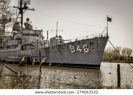 Bay City, Mi. USA. April 23, 2015. The USS Edson naval destroyer docked in Bay City. The destroyer served in Vietnam and was decommissioned in 1988. It is currently a museum and open to the public. - stock photo