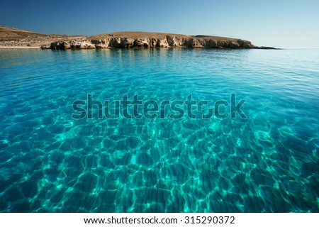 Bay in Rinia or Dilos with clear transparent swimming waters, Mykonos, Cyclades islands, Greece. - stock photo