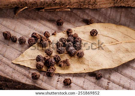bay leaf and black pepper - stock photo