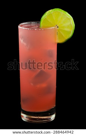 Bay of Passion, a pink drink that contains vodka, cranberry juice, pineapple juice,passion fruit liqueur and garnished with a slice of lime. Isolated on black. - stock photo