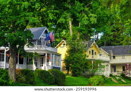 BAY VIEW, MI - JUNE 26, 2014: Quaint old homes, many of them providing tourist lodgings, line the shady streets of this one-time Methodist retreat center next to Petoskey on Lake Michigan. - stock photo