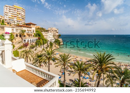 Bay with a beach and hotels in Mallorca. Panorama of the bay to the beach, palm trees and hotels in Mallorca. - stock photo