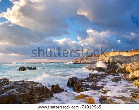 Bay with greater stone and wave. Seascape with bright color