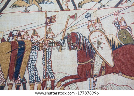 BAYEUX, FRANCE - FEB 12: Detail of the Bayeux Tapestry depicting the Norman invasion of England in the 11th Century on February 12, 2013.  - stock photo