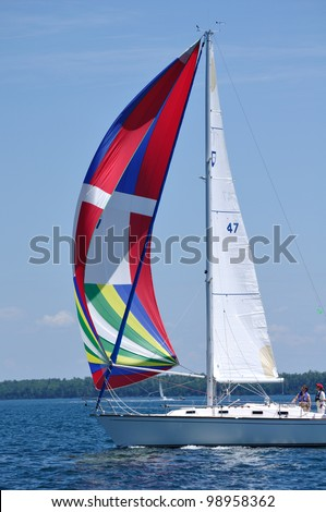 BAYFIELD, WI - JULY 4: Sailboat Sailing in Annual Bayfield Race Week Competition on Lake Superior on July 4, 2011 near Bayfield, Wisconsin - stock photo
