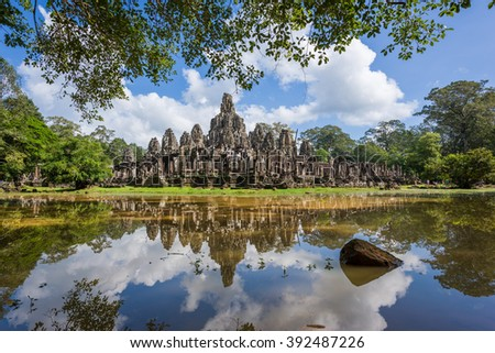 Bayon Temple reflection. Bayon Temple was built as the official state temple of the Mahayana Buddhist King Jayavarman VII. - stock photo