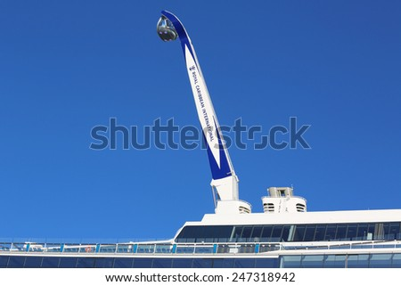 "BAYONNE, NEW JERSEY - NOVEMBER 18, 2014: The ""NorthStar"" observation tower at the newest Royal Caribbean Cruise Ship Quantum of the Seas docked at Cape Liberty Cruise Port  - stock photo"