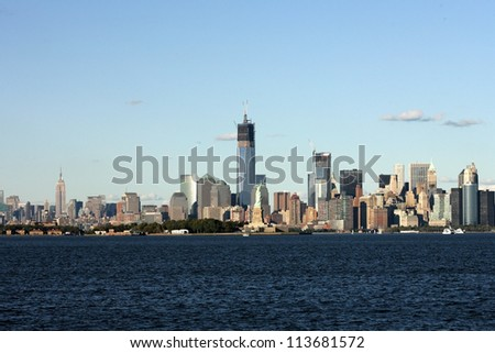 BAYONNE, NJ - SEPT 23: A view of the Freedom Tower, the Statue of Liberty and lower Manhattan are shown on September 23, 2012 in this view from Bayonne, NJ. The Empire State Building is on left.