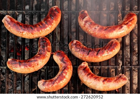 BBQ Bratwurst Spicy Browned Sausages On The Hot Grill, Top View - stock photo