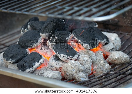 BBQ briquettes on the grill - stock photo