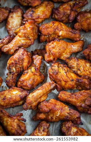 BBQ chicken wings on baking sheet - stock photo