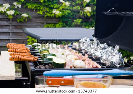 BBQ cooking. Raw material placed on the grate. - stock photo