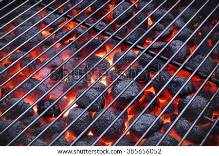 BBQ Grill And Glowing Hot Charcoal Briquettes In The Background, Close-Up, Top View. Concept For Outdoor Barbecue Party Or Picnic Or Cookout - stock photo