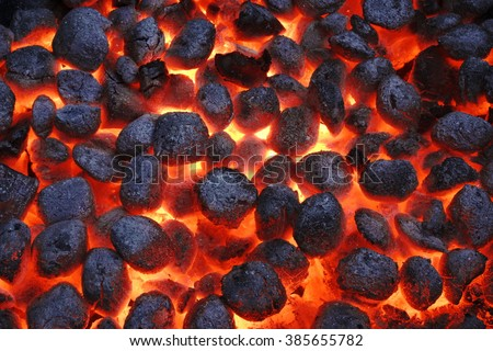 BBQ Grill Pit With Glowing And Flaming Hot Charcoal Briquettes, Food Background Or Texture, Close-Up, Top View - stock photo