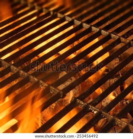BBQ Grill with Glowing Coals and Bright Flames - stock photo