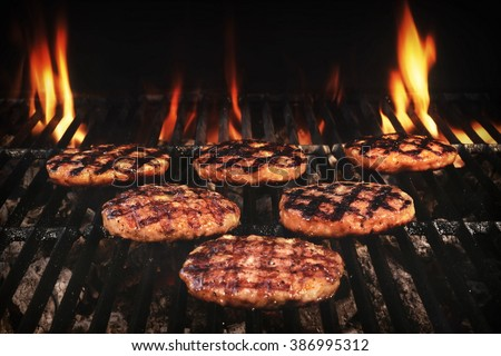 BBQ Grilled Burgers Patties On The Hot Flaming Charcoal Grill, Top View. Cookout Food, Good Snack For Outdoor Party Or Picnic - stock photo