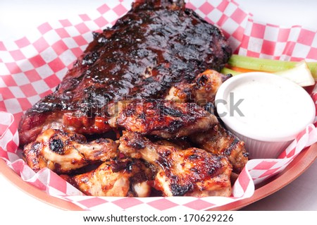 bbq half rack of ribs with a pound of wings