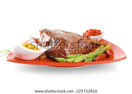 bbq meat with spices on red dish - stock photo