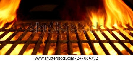BBQ or Barbecue or Barbeque or Bar-B-Q Charcoal Fire Iron Empty Grill with Flames Isolated on Black Background - stock photo
