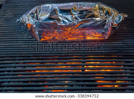 bbq party aluminum foil  barbecue grill - stock photo