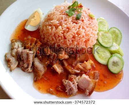 BBQ Pork and Crispy Pork with Rice on black background - stock photo