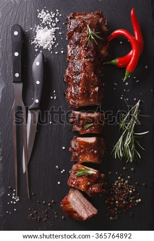 BBQ pork ribs chopped on a table with the ingredients. vertical top view