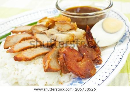BBQ Pork, sausage and crispy pork over the rice, thai food style. - stock photo