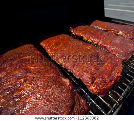 BBQ ribs cooking on a hot grill - stock photo