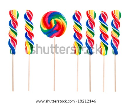 Be different, a bright rainbow lollipop puts a different twist on things. - stock photo